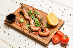 Shrimps with lemon and sauce Stock Images