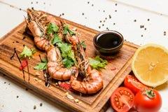 Shrimps with lemon and sauce Stock Photos