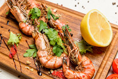 Shrimps with lemon and sauce Stock Photo
