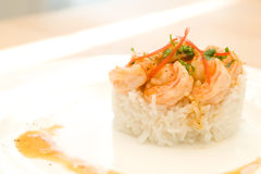 Shrimps with lemon sauce on rice. Shrimps on rice with beautiful lemon sauce napping Royalty Free Stock Images