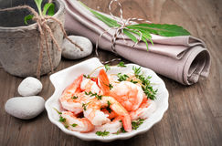 Shrimps in lemon sauce in a scallop shell dish Royalty Free Stock Photos