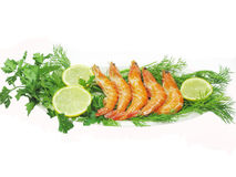 Shrimps with lemon slices and parsley Stock Images