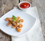 Shrimps with lemon and spicy sauce on the wooden background Royalty Free Stock Photo