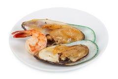 Shrimps, mussels Stock Photos