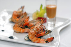 Shrimps and mussels with sauce Stock Images