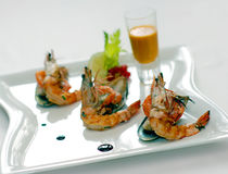 Shrimps and mussels with sauce Royalty Free Stock Images