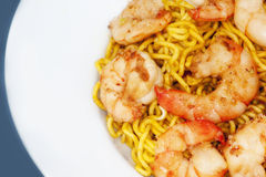 Shrimps and noodles on a plate. Oriental plate with shrimps and egg noodles Royalty Free Stock Images