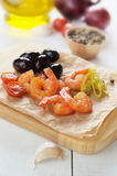 Shrimps and olives Royalty Free Stock Image