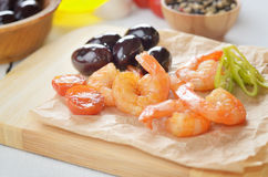 Shrimps and olives Stock Photography