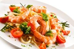 Shrimps with pasta Stock Photos
