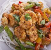 Shrimps with Peanut Sauce and Rice Noodles. Close up stock photography