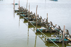 At shrimps pond in the rainy season,and paddle wheel aerator Royalty Free Stock Photography