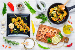 Shrimps and Prawn Cooked and Raw Top View. Cooking Shrimps and Prawns in Top view with Vegetables, Spices and Ingredients Royalty Free Stock Image