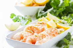 Shrimps prawns with fresh herbs and lemon Stock Photos