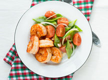 Shrimps (prawns) and fresh snow peas and tomato salad Stock Images
