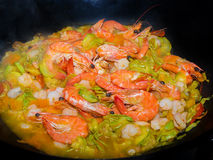 Shrimps, Prawns,  marrows and carrots cooked in a smoking pan Stock Images