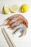 Shrimps and prawns. Seafood detail with cut lemons fresh, healthy food Stock Image