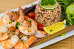 Shrimps and rice on the plate Royalty Free Stock Photos