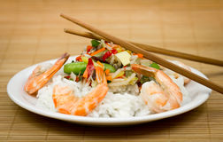 Shrimps and rice on the plate with vegetables Royalty Free Stock Photo