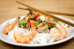 Shrimps and rice on the plate with vegetables Royalty Free Stock Image