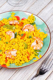 Shrimps Risotto garnished with fresh parsley and red chili pepper Royalty Free Stock Photo
