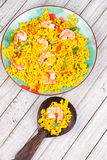 Shrimps Risotto garnished with fresh parsley and red chili pepper Stock Images