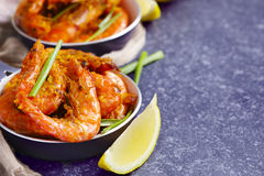 Shrimps roasted on frying pan with lemon and garlic Royalty Free Stock Images