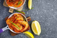 Shrimps roasted on frying pan with lemon and garlic Royalty Free Stock Photography