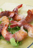 Shrimps rolled in prosciutto Royalty Free Stock Images