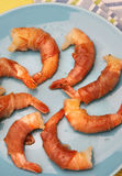 Shrimps rolled in prosciutto Stock Photos