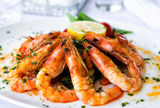 Shrimps salad. Fried shrimps on a plate with vegetables Royalty Free Stock Photography