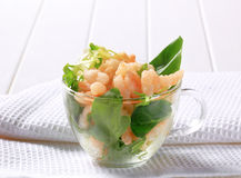 Shrimps with salad greens Stock Image