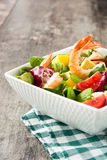 Shrimps salad with mango and avocado on wood Royalty Free Stock Photography