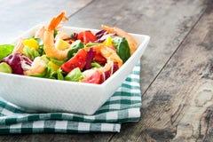 Shrimps salad with mango and avocado on wood Royalty Free Stock Photos