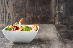 Shrimps salad with mango and avocado on wood Royalty Free Stock Images