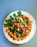 Shrimps salad plate on blue. Dish with shrimps salad royalty free stock image
