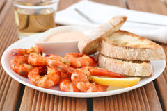 Shrimps with sauce and bread Stock Photography