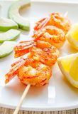 Shrimps skewers with avocado and lemon slices Royalty Free Stock Photo