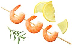 Shrimps skewers with lemon and rosemary isolated on a white background. top view royalty free stock images