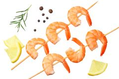 Shrimps skewers with lemon and rosemary isolated on a white background. top view royalty free stock photography