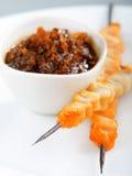 Shrimps skewers with teriyaki sauce Stock Photography