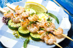 Shrimps skewers with zucchini Stock Photo