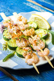 Shrimps skewers with zucchini Stock Images