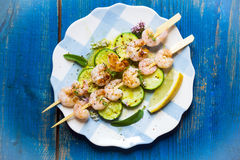 Shrimps skewers with zucchini Royalty Free Stock Photo