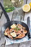 Shrimps in a skillet Stock Images