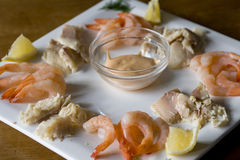 Shrimps and smoked trout on a plate Royalty Free Stock Photos