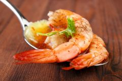 Shrimps on spoon Stock Photos