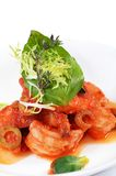 Shrimps in tomato sauce with olives. The shrimps in tomato sauce with olives Stock Image