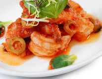 Shrimps in tomato sauce with olives. The shrimps in tomato sauce with olives Royalty Free Stock Photo