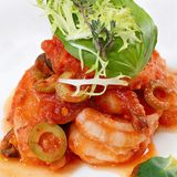 Shrimps in tomato sauce with olives. The shrimps in tomato sauce with olives Royalty Free Stock Photography